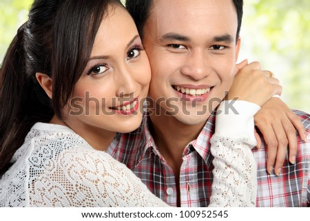 close up portrait Happy young couple embracing