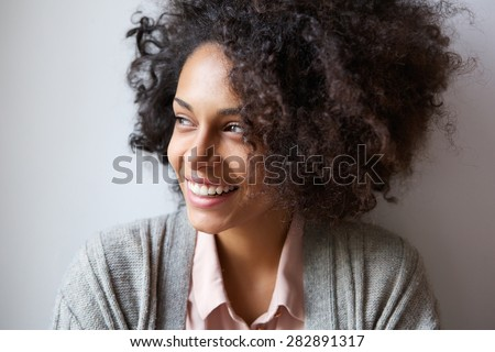 Close up portrait of a beautiful black woman smiling and looking away #282891317
