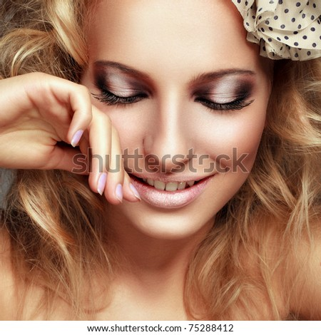 Close-up portrait of a beautiful blond girl