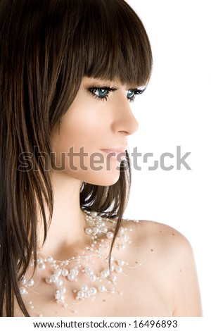 Close-up portrait of a beautiful brunette woman - stock photo