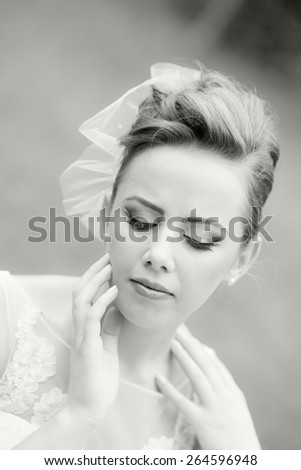 Close up portrait of a beautiful, caucasian, long haired woman wearing a wedding dress, looking happy and melancholic. Black and white photography #264596948