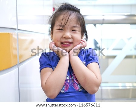 Close-up portrait of a beautiful cute girl with smiling indoor