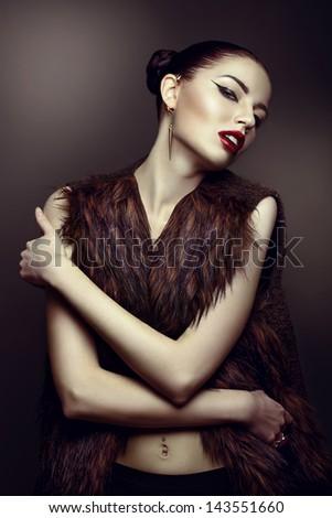close-up portrait of a beautiful girl in a fur coat
