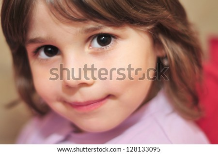 close-up portrait of a beautiful little girl