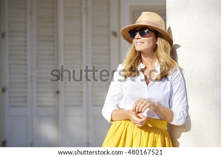 Close-up portrait of a beautiful middle aged lady enjoying a summer day outdoor. #480167521
