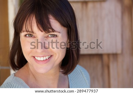 Close up portrait of a beautiful older woman smiling