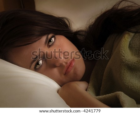 Close up portrait of a beautiful Woman In Bed