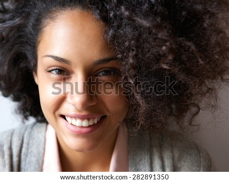 Close up portrait of a beautiful young african american woman smiling - Shutterstock ID 282891350