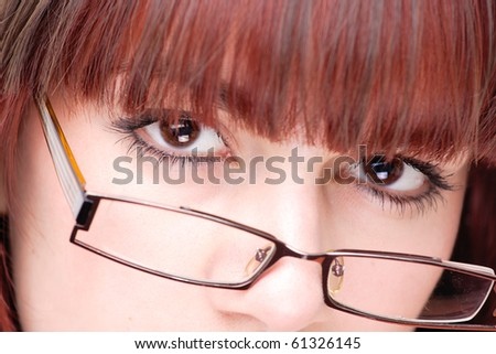 Close up portrait of a beautiful young businesswoman wearing glasses