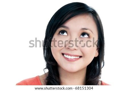 Close-up portrait of a beautiful young woman looking up over white background.