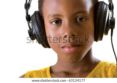 close-up portrait of a boy listening to soothing music on headphones