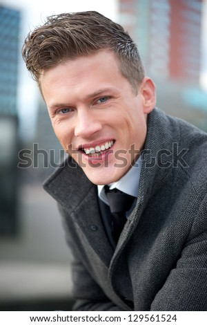 Close up portrait of a businessman smiling outdoors - stock photo