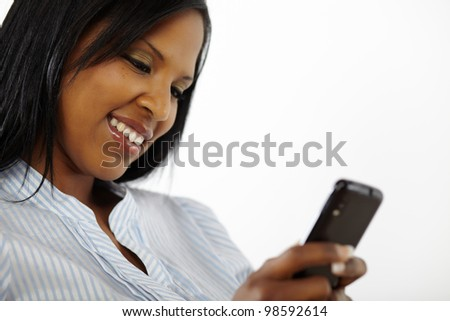 Close up portrait of a charming beautiful young woman reading a text message on mobile phone