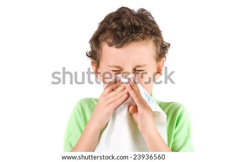 Close-up portrait of a child wiping his nose