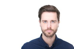Close up portrait of a confident young man with beard looking at camera