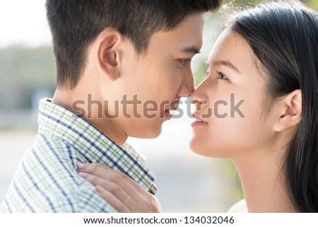 Close-up portrait of a couple looking at each other