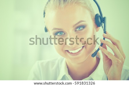 Close-up portrait of a customer service agent sitting at office #591831326