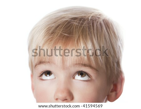 Close-up portrait of a cute little boy looking up.