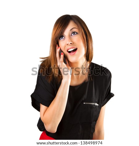 Close up portrait of a cute young woman on mobile phone while looking at copy space. Isolated on white background.