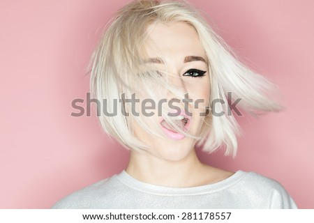 Close-up portrait of a fashion blonde with stylish short hairstyle