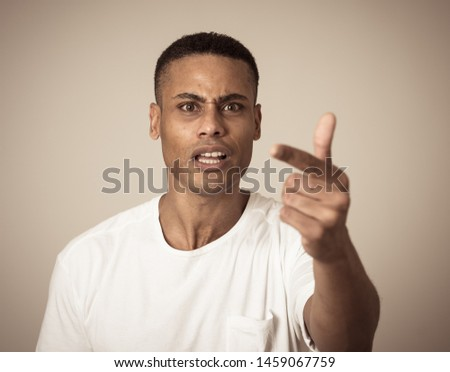 Close up portrait of a handsome african american man with a surprised and shocked face. Attractive male looking amazed with wide eyes and mouth open in surprise. Human facial expressions and emotions. #1459067759