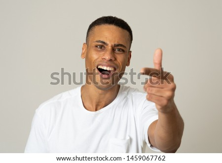 Close up portrait of a handsome african american man with a surprised and shocked face. Attractive male looking amazed with wide eyes and mouth open in surprise. Human facial expressions and emotions. #1459067762