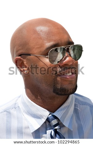 Close up portrait of a handsome business man wearing sunglasses isolated over white.