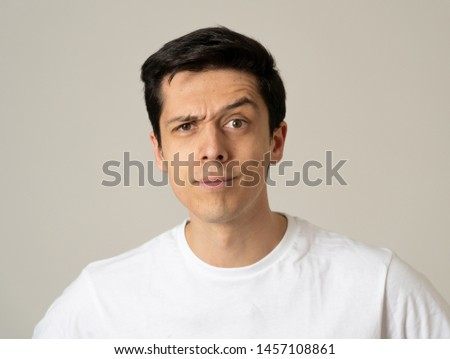 Close up portrait of a handsome caucasian young man with a surprised and shocked face. Attractive male looking amazed with wide eyes and mouth open in surprise. Human facial expressions and emotions. #1457108861
