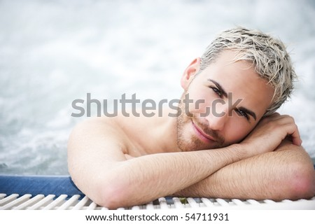 Close up portrait of a handsome man in jacuzzi with closed eyes