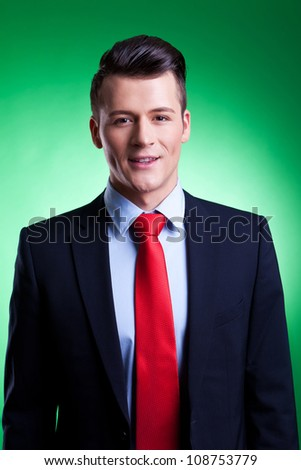 Close-up portrait of a handsome young business man on green background