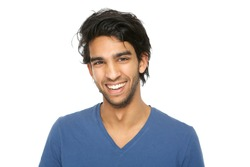 Close up portrait of a handsome young indian man smiling on isolated white background