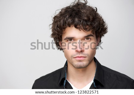 Close up portrait of a handsome young man looking at camera.