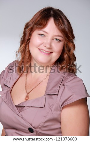 Close up portrait of a happy smiley mid adult woman