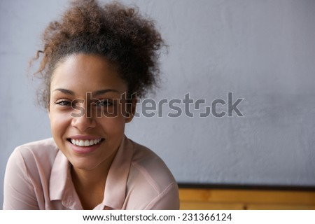 Close up portrait of a happy young black woman smiling