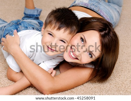 Close-up portrait of a joyful  laughing  mother and her  little boy