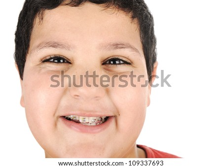 Close-up portrait of a kid with braces