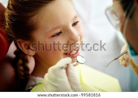Close up portrait of a little smiling girl at dentist�¢??s office