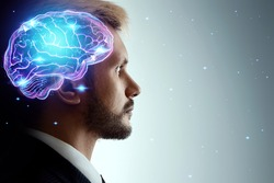 Close up portrait of a man from the side in profile and a hologram of a working brain. The concept of intelligence, brain work, thought process