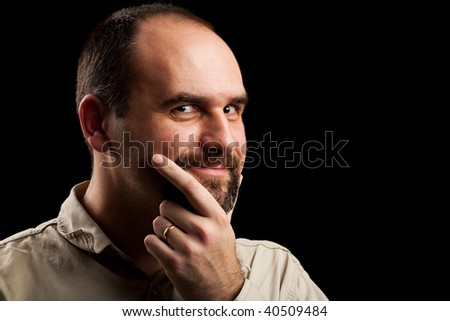 Close up portrait of a pensive or doubtful young businessman, studio shot