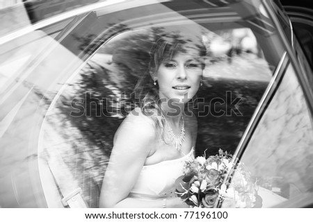 close-up portrait of a pretty bride in a car window