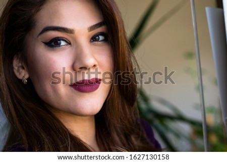 Close-up portrait of a pretty young woman. Only head in the frame