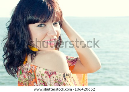 Close-up portrait of a sensual young woman enjoying summer evening