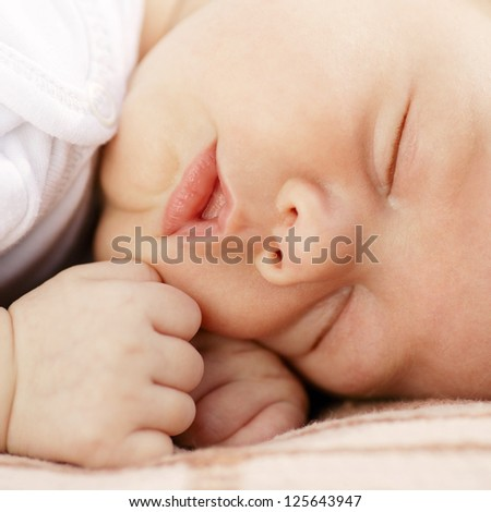 close-up portrait of a sleeping baby on white