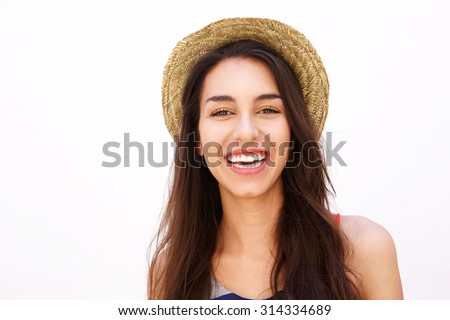 Shutterstock Close up portrait of a smiling cute girl with long hair and hat posing against white background