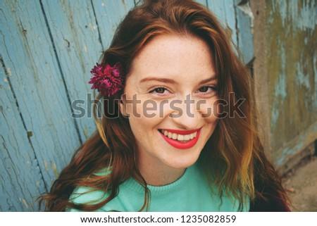 Close up portrait of a smiling girl. Pretty girl. Pretty woman.