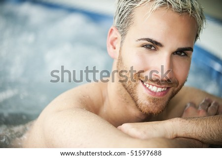 Close up portrait of a smiling handsome man in jacuzzi