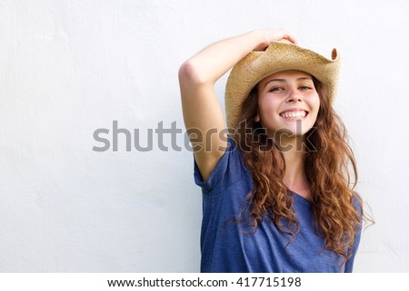 Close up portrait of a smiling young woman with cowboy hat #417715198