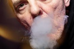 close up portrait of a smoking man