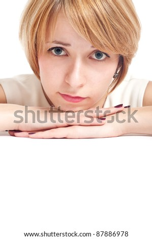 close-up portrait of a student girl with thoughtful expression on her face  blue eyes with white copy-space to paste your advert