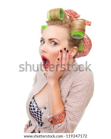 Close-up portrait of a surprised / socked pin up girl isolated on white background in studio. Old / retro fashion style photo